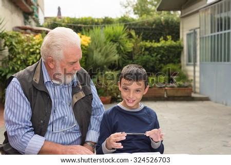 Mature teacher with pupil outdoor. - stock photo