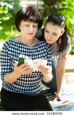 Mature woman and her teenage daughter - stock photo