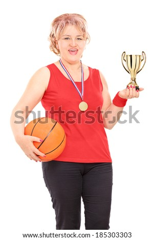 Mature woman holding trophy and a basketball isolated on white background - stock photo