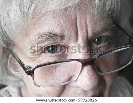 Mature woman in glasses - stock photo