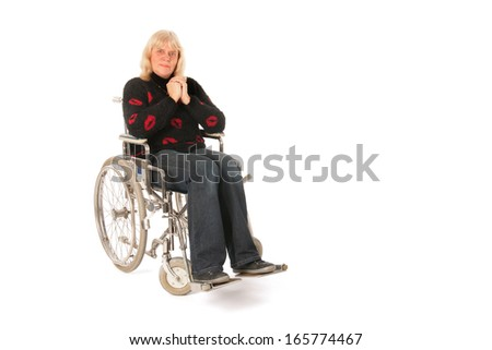 Mature woman in wheelchair isolated over white background - stock photo