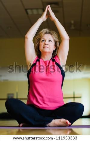 Mature Woman in Yoga Prayer Pose - stock photo