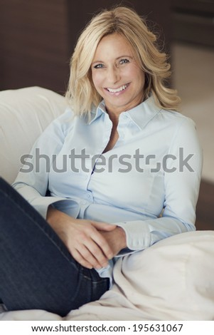 Mature Woman Relaxing At Home - stock photo