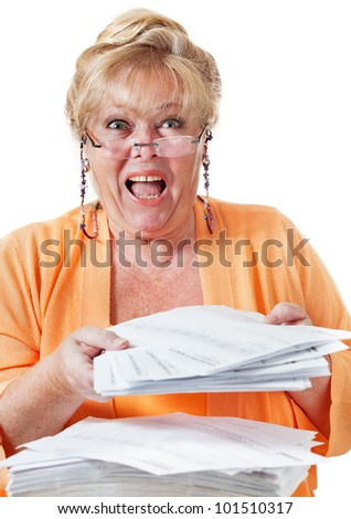 Mature woman screams in frustration over a huge stack of insurance forms and healthcare paperwork - stock photo