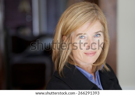 Mature Woman Smiling At The Camera - stock photo