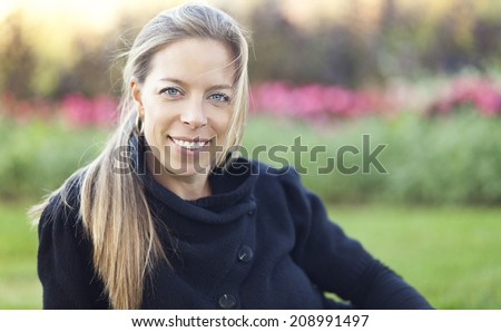 Mature Woman Smiling AT The Park - stock photo