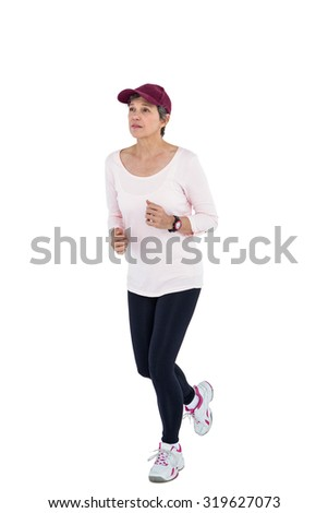 Mature woman wearing cap jogging against white background - stock photo