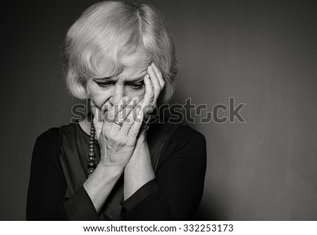 Mature woman with problems. B&W. - stock photo