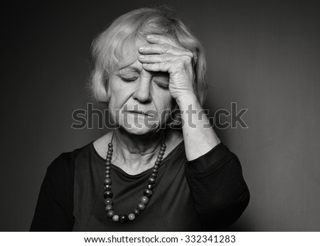 Mature woman with problems. Black and white. - stock photo