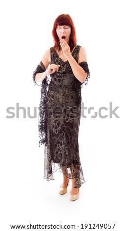 Mature woman yawning - stock photo