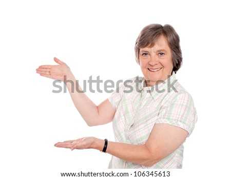 Matured woman representing copy space isolated against white background - stock photo