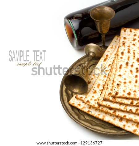 Matzo and wine for passover seder celebration on white background - stock photo