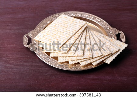 Matzo for Passover on metal tray on table close up - stock photo
