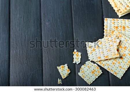 Matzo for Passover on table  close up - stock photo