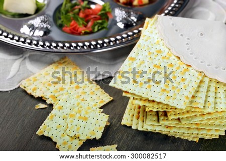 Matzo for Passover with Seder meal on plate on table close up - stock photo