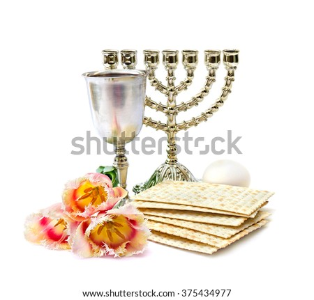 Matzo, wine, menorah, egg and tulips for passover celebration on white background - stock photo