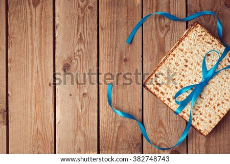 Matzoh for jewish holiday Passover (pesah) on wooden background. View from above - stock photo