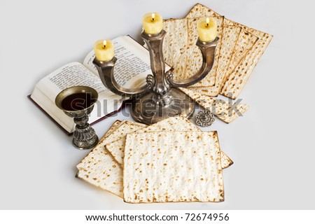 matzot and candlestick  with burning candles - stock photo