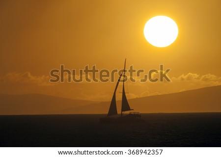 Maui, Sunset and yacht seen from Kahana, Hawaii -2 - stock photo
