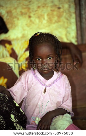 MAURITANIA - JANUARY 6: Mauritanian girl is playing with her new toy received from the Budapest - Bamako Rally participants  on January 6, 2006, Mauritania - stock photo