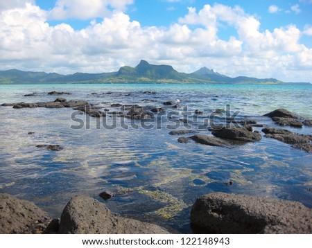 Mauritius Lion mountain across coastal bay - stock photo