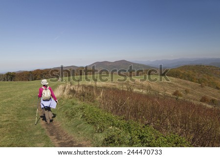 Max Patch, North Carolina, USA - October 17, 2014: Scenic view of hikers walking through the picturesque Appalachian Mountains in autumn on October 17, 2014 in Max Patch, North Carolina  - stock photo