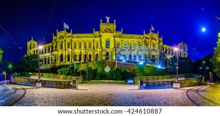 Maximilianeum during night - Bavarian state parliament with flags in Munich, Bavaria Germany - stock photo