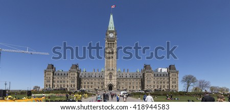 May 10, 2016 - Ottawa, Canada -  Tourists on Parliament of Canada Building - stock photo