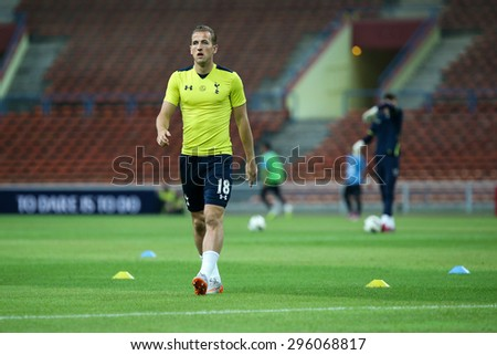 May 27, 2015 - Shah Alam, Malaysia: Tottenham Hotspur's top striker Harry Kane warms up on the pitch before a friendly match in Malaysia. Tottenham Hotspur is on a Asia-Australia tour. - stock photo