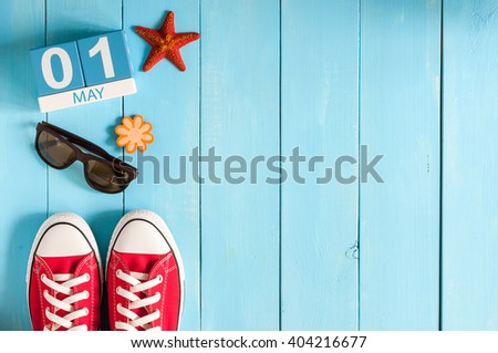 May 1st. Image of may 1 wooden color calendar on blue background.  Spring day, empty space for text.  International Workers' Day - stock photo