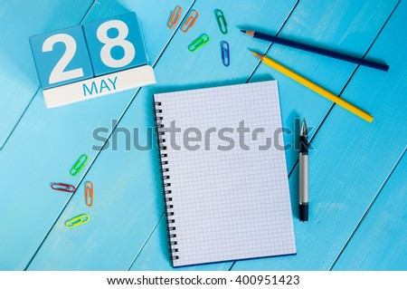May 28th. Image of may 28 wooden color calendar on blue background.  Spring day, empty space for text - stock photo