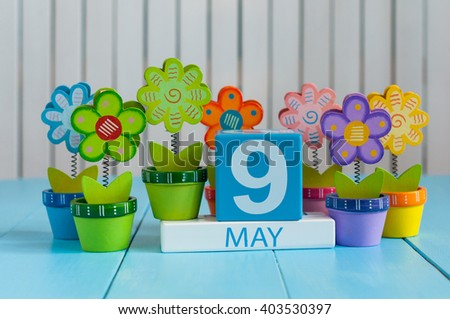 May 9th. Image of may 9 wooden color calendar on white background with flowers. Spring day, empty space for text.  Symbols Of the victory in World War II - stock photo