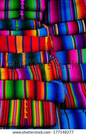 Mayan blankets textile designs on the market in Chichicastenango Guatemala - stock photo