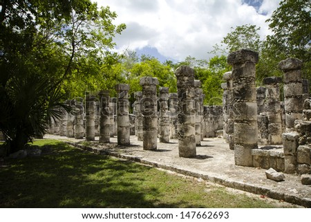 Mayan columns in the Mexican jungle - stock photo