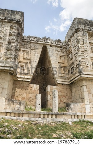 Mayan Corbel Arch in Uxmal This arrow shaped arch is very typical of Mayan archeological sites but very spectacular in the ruins in Uxmal in Yucatan, Mexico  - stock photo