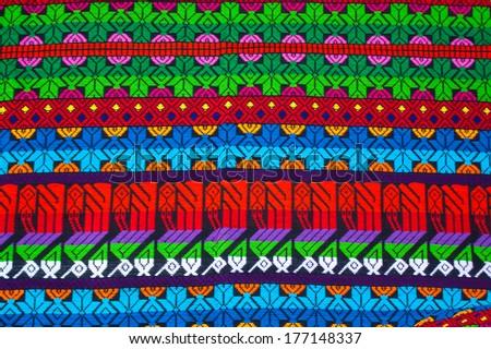 Mayan ornament on a blanket at Chichicastenango market Guatemala - stock photo