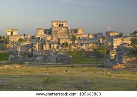 Mayan ruins of Ruinas de Tulum (Tulum Ruins) in Quintana Roo, Mexico. El Castillo is pictured in Mayan ruin in the Yucatan Peninsula, Mexico at sunset - stock photo