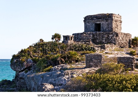 Mayan ruins perched on a cliff above the ocean at Tulum, Quintana Roo, Mexico. - stock photo