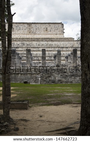 Mayan temple appears in the midst of the jungle - stock photo