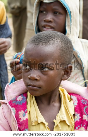 MAYANGE; RWANDA - NOVEMBER 4: Unidentified child from the UN Millenium village at November 4; 2013. It is a village of returnees-who came back to Rwanda after the 1994 genocide. - stock photo