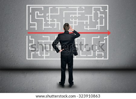 Maze and business man thinking solution - stock photo