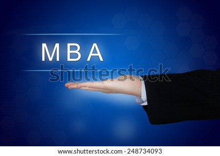 MBA or Master of Business Administration button with business hand - stock photo