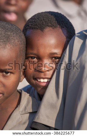 MBABANE, SWAZILAND - AUGUST 6: Unidentified orphan Swazi schoolboys in a local school on August 6, 2008 in Mbabane, Swaziland. 10 percent of Swaziland's total population are orphans, due to HIV/AIDS. - stock photo