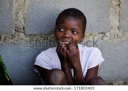 MBABANE, SWAZILAND- JULY 30: Portrait of unidentified Swazi girl on July 30, 2008 in Mbabane, Swaziland. Close to 10 percent of Swaziland�s total population are orphans, due to HIV/AIDS. - stock photo
