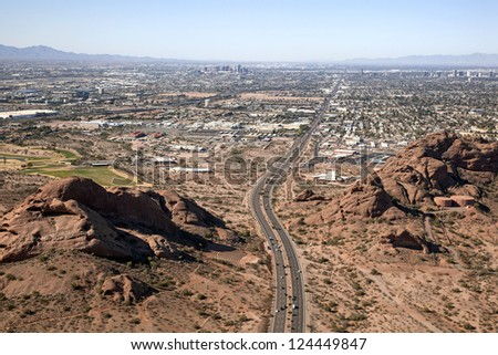 McDowell Road through the red rocks of the Papago Buttes in Phoenix, Arizona - stock photo