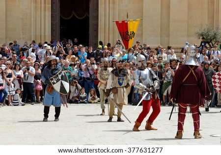 MDINA, MALTA - APRIL 19: The Mdina medieval festival and tourists on April 19, 2015 in Mdina, Malta.  - stock photo