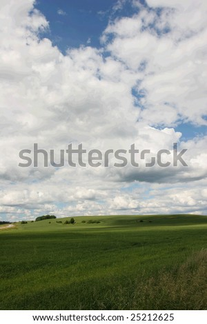 Meadow and cloudy sky (Latvia) - stock photo