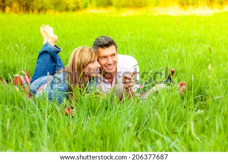 meadow showing looking couple green - stock photo