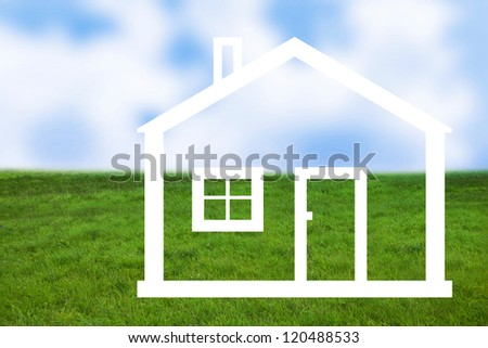 Meadow with drawing of house - stock photo