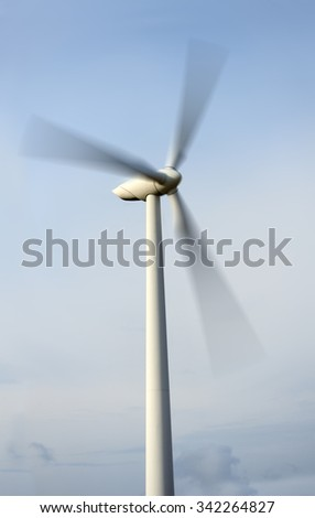 Meadow with Wind turbines generating electricity. Ecology - Wind power - stock photo